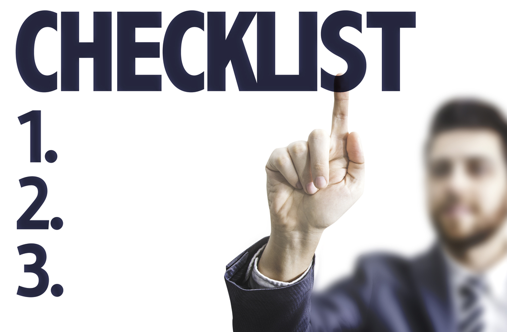 Business man pointing the text Checklist