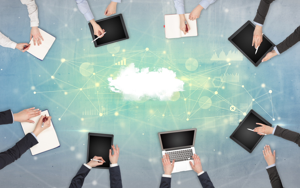 Group of people with devices in hands working on reports with online teamwork and cloud technology concept-1