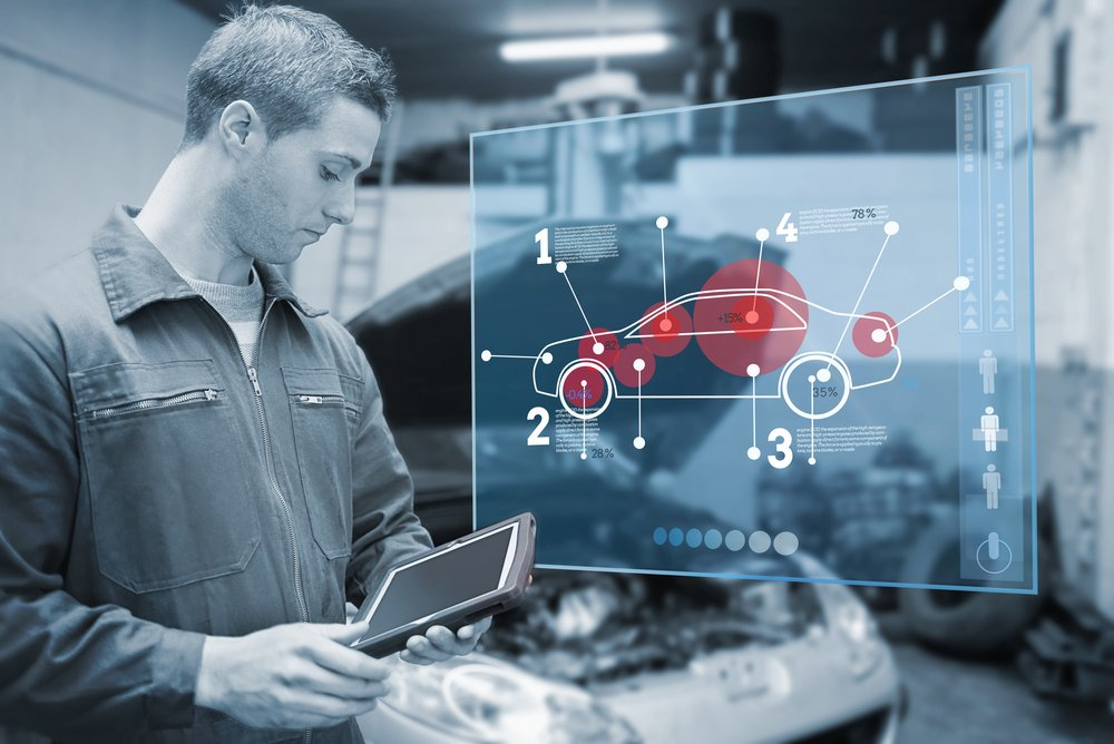 Mechanic using tablet and futuristic interface with diagram  in black and white