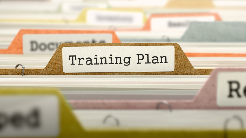 Training Plan on Business Folder in Multicolor Card Index. Closeup View. Blurred Image.