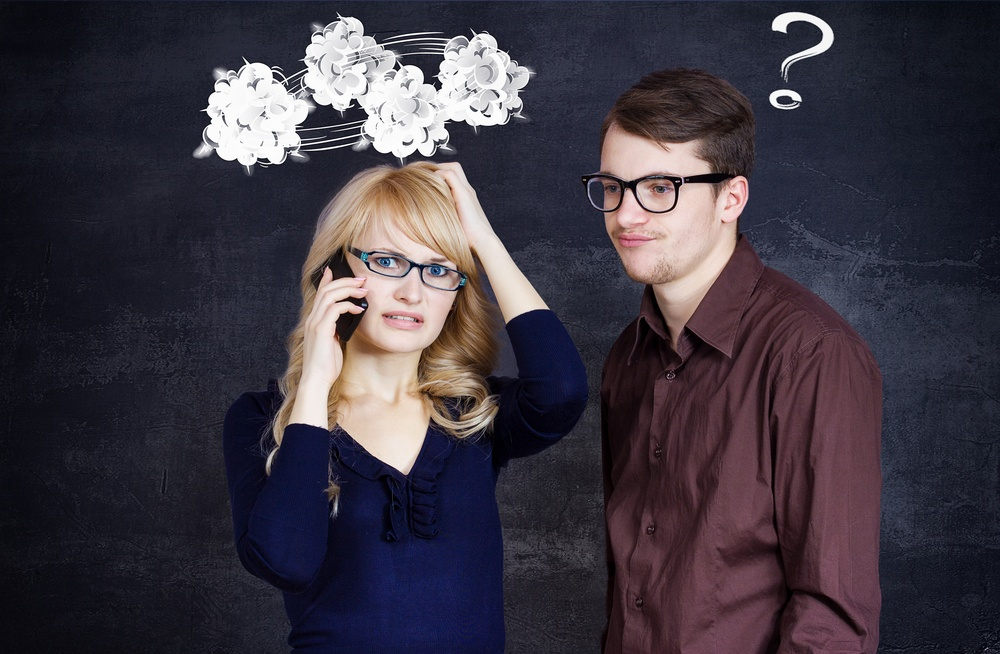 Portrait stressed couple going through hard times in relationship isolated grey background clouds above woman head question mark coming out of confused man. Upset girlfriend bringing bad news on phone